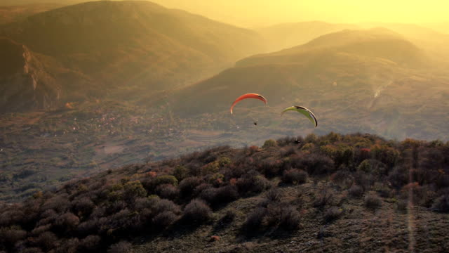 Paraglider Soaring Over The Mountains video