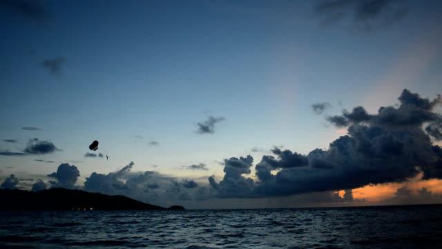 Paragliding at sunset beach video