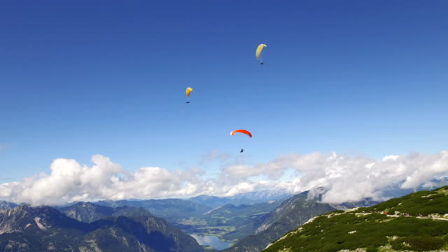 paragliding over the rocky Alps mountains landscape video