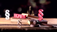 paragraphs, books, gavel and money, dolly shot video