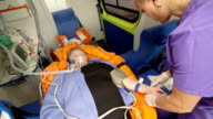 EMT paramedic preparing an intravenous infusion to patient in ambulance video