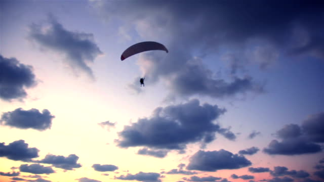 Paraplane in the sky before a sunset video