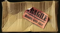 Parcel damaged in the post with fragile sign on it video