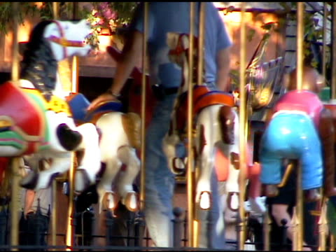 Parent Riding Merry Go Round Carrousel with Child video