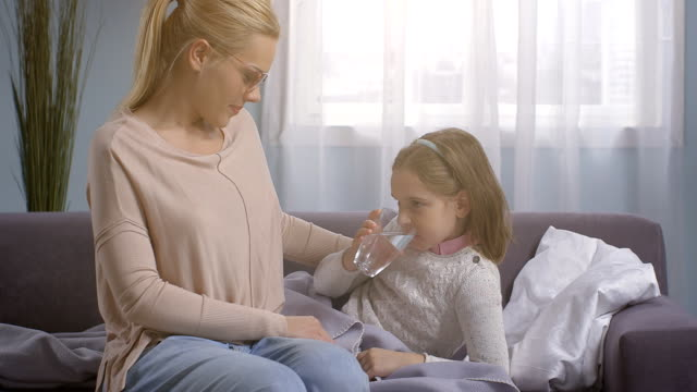 Parent taking care of a sick child video