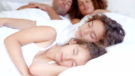Parents and children sleeping together video