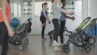 4K: Parents exercising with their babies in strollers. video
