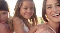 Parents Giving Children Piggyback Ride In Garden video