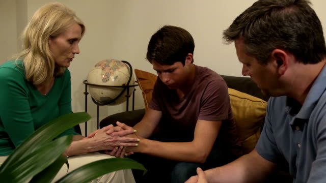 Parents have Serious Discussion with Son - Wide Shot video