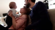 Parents playing with their baby video