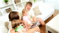 Parents Pre School Daughters Playing Wireless Technology video