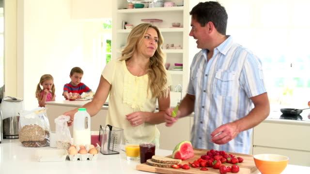 Parents Preparing Family Breakfast In Kitchen video