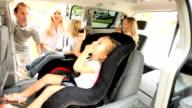 Parents Putting Children Family Car Seats video