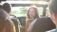 Parents Taking Children On Trip In Open Top Car video