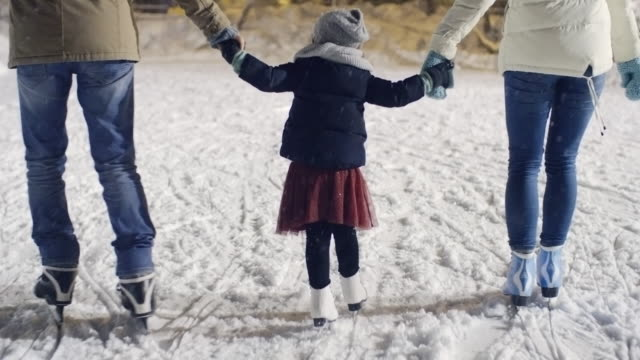 Parents Teaching Little Girl to Ice Skate video