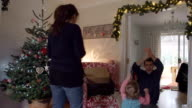 Parents Turing On Christmas Lights For Toddler Daughter video