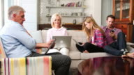 Parents With Adult Offspring Using Digital Devices At Home video