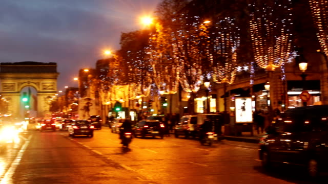 Paris City Traffic on the Champs Elysees at Night During Christmas video