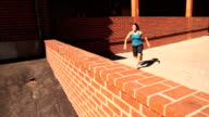Parkour girl uses various vaults to overcome her obstacles video
