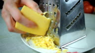 Parmesan cheese on chopping kitchen grater video