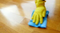 Parquet. Cleaning wooden floor. video