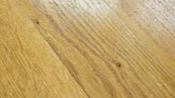 Parquet. Drops of water on wooden surface. video