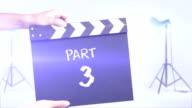 Part 3 film slate in a studio shot background video