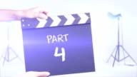 Part 4 film slate in a studio shot background video