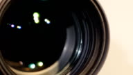 Part of camera zoom lens, glare, close up video