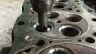 Part of car engine, four valve in head for each cylinder.Machining valve seat. video
