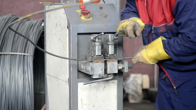 part of the machine for welding wire mesh in action video