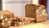 Partially sliced loaf of fresh rye bread, zoom in. video