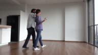 Partner covering eyes of girlfriend surprising her with new apartment video