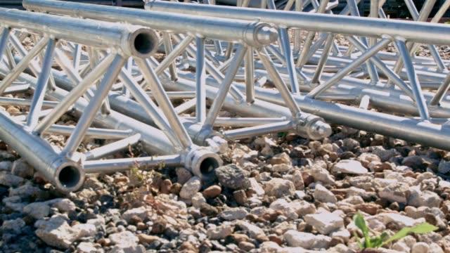 Parts of Alluminium truss lying on the ground video