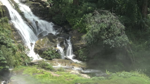Parts of  Wachirathan waterfall with water splash. video