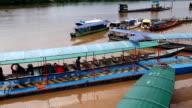 Passenger boats docked on the Amazon video
