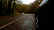 Passenger Car Driving Along Winding Road In Autumn Forest video