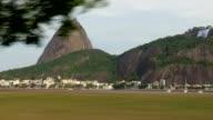Passenger shot of Rio de Janeiro's Pao de Açucar from a moving vehicle video