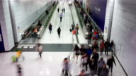 passenger taking escalator in airport,time lapse. video