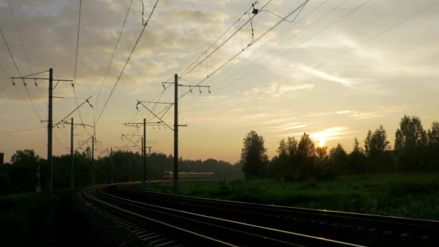Passenger train in rural area at sunset video