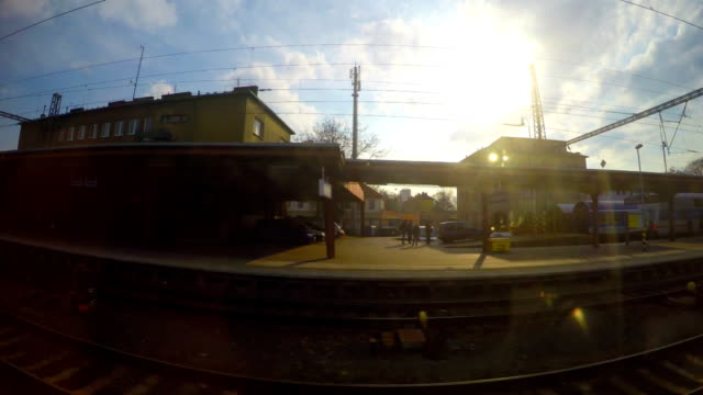 Passenger train passing railway station, arrival at destination, industrial view video