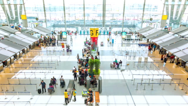 Passengers at Airport Check In Counter Hall,Panning Shot video