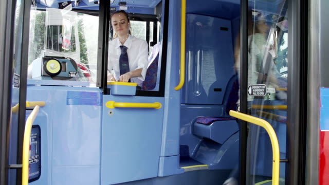 Passengers Boarding Bus Using Passes And Buying Tickets video