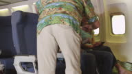 Passengers finding seats on planes video