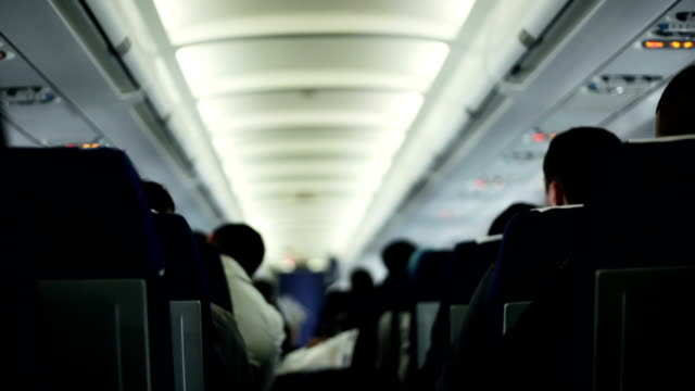 Passengers in a commercial airplane during a flight video