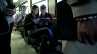 Passengers on a bus playing with digital tablet video