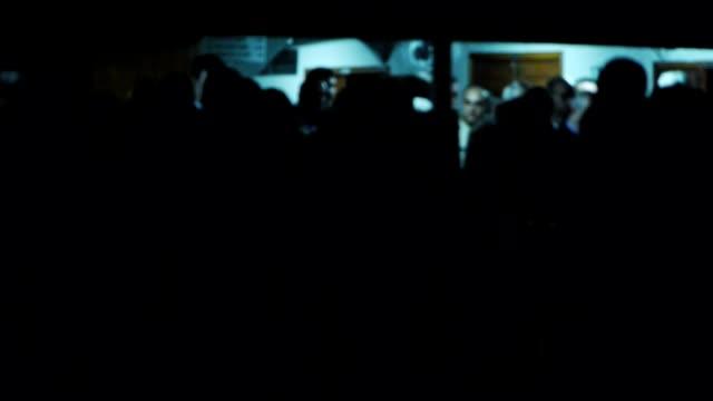 Passengers waiting to board ship at night - Travel video