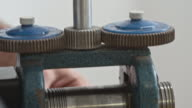 Passing Metal Thing Through Rollers video