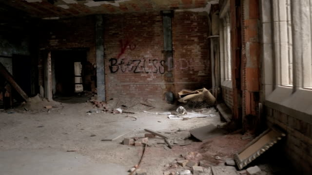 FPV: Passing through a demolished room in abandoned industrial building in ruins video