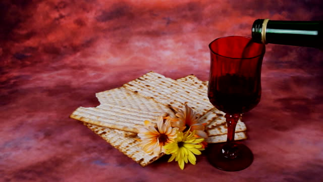 Passover background. wine and matzoh jewish holiday bread over wooden board video